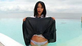 Innocent Asian schoolgirl gets wet outdoors.