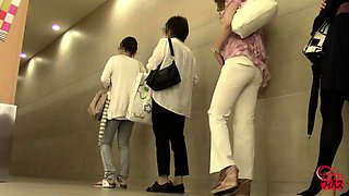 Lovely amateur Japanese babes pissing on hidden toilet cam