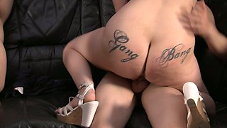 Tattooed hooker tries to satisfy several nerd dudes and one fat guy