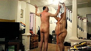 Fat mature brunette with glasses spanks her helpless slave