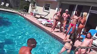 Pretty little gals sucking cocks during some wild pool party