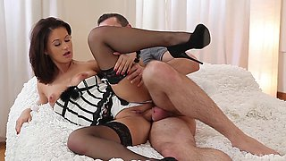 Madlin wearing stockings and a corset gets fucked from behind