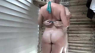 Couple having sexy sex in outdoor shower