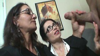 Naughty boss jerks off and makes his two secretaries finish him