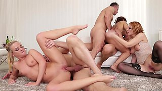 Three girls with fine asses make an orgy with three men on the sofa