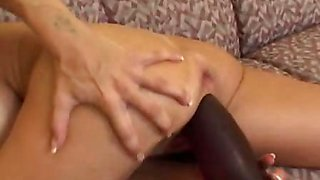 Shannon inserting a long brutal anal dildo