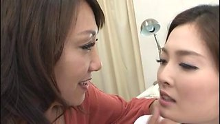 A pair of Japanese lesbians enjoys kissing and hugging