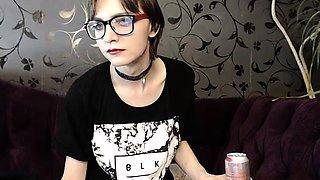 Nerdy brunette shemale in fishnets masturbates on the webcam