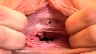 Lovable girl is gaping tight quim in close up and climaxing