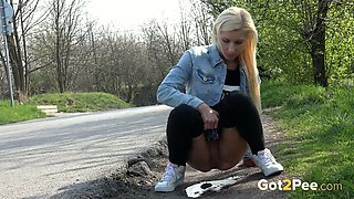 A gorgeous blonde decides to pee outside and she is so brave and nasty