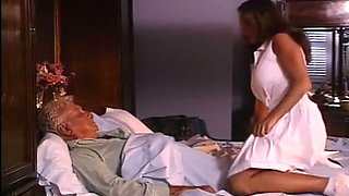 Sensational busty sultry slut on the bed flashes her breasts
