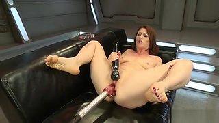 Anal plugged redhead fucks machine