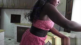 Busty African babe banged in kitchen