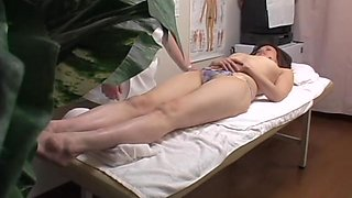 Japanese fingered to orgasm in voyeur massage video