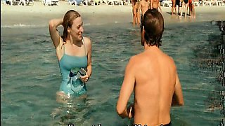 Valeria Bruni nude sitting in bed as a guy kisses her. They