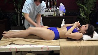 Charming Asian babe is made to cum hard on the massage bed
