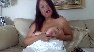 Mature woman using egg vibrator, masturbating cutting panties with scissors