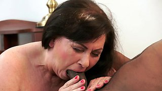 Fat granny is tasting a big black cock in her pretty mouth