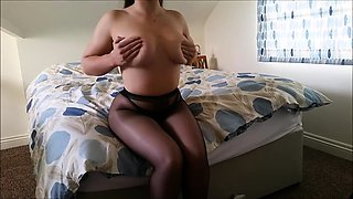 Bodacious brunette in pantyhose shows off her amazing body