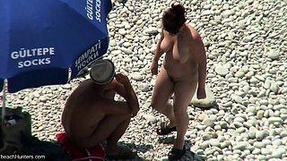 Voyeur films couple fucking on the beach