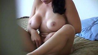 Hidden Camera Sh Ow Of A Babe Stripping Then She Uses A Dildo