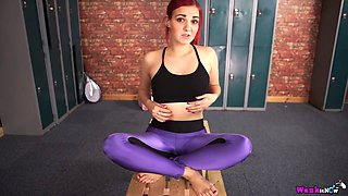Sporty redhead Dolly flashes her boobies and sucks a fake cock