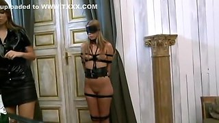 Domme in high boots uses her tied up slave
