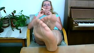 Provocative blonde in pantyhose shows off her lovely feet
