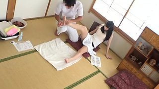 Japanese brunette MILF gets a foot massage before riding cock