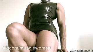 Female bodybuilder: brigit brezovic flexing in latex dress