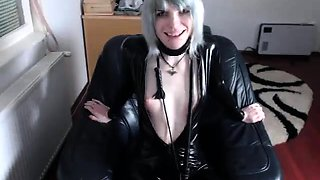 Provoking amateur girl in latex pleases herself on webcam