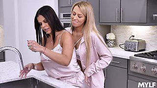 Real scissoring with two voluptuous lesbians while in the kitchen