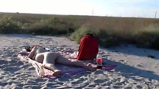 Nudist girl sucks off her bf, while her milf is sun bathing.