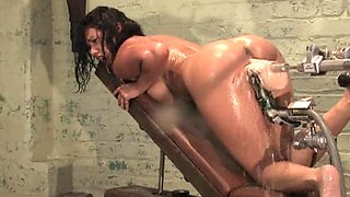 Brunette sweats during a hot acquaintance with a fucking machine!