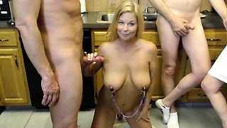 Two kinky mature couples engage in group sex in the kitchen