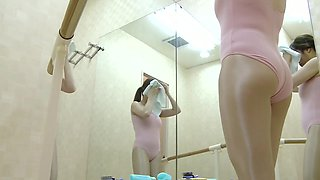 Cute Asian gymnast gets her costume off in the change room