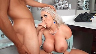 Blond mom with big milkings has sex with a young guy...