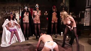 Bunch of Mistresses Fuck a Guy With a Strapon