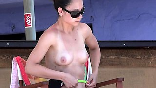 Beach voyeur finds a perky breasted babe under the hot sun