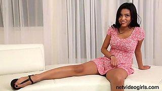 Beautiful petite Latina stripping on camera