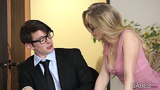 Mini-skirt clad blonde with glasses enjoying a missionary style fuck