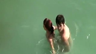 Young couple fucks in the water