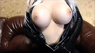 Voluptuous amateur milf in latex teases with a big dildo