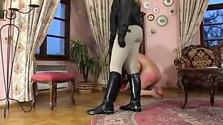 Mistress in riding boots