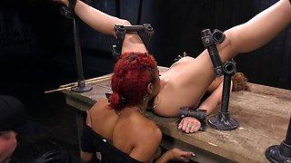 Cold metal is keeping this helpless slavegirl in place