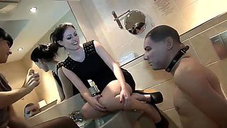Two sultry amateur babes in high heels dominate their slave
