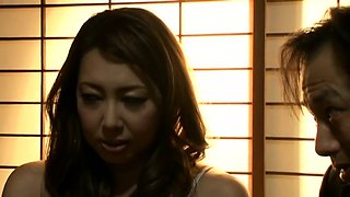 Voluptuous Asian milf in stockings gets fucked by two guys