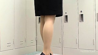 Elegant Oriental babe with sexy legs puts on her pantyhose