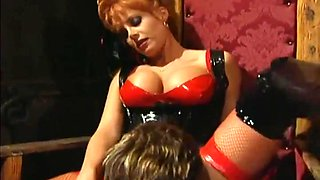Red Head In Latex Pleases And Pleasures Him
