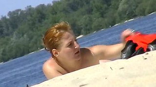 Completely naked mom sunbathing at the river beach